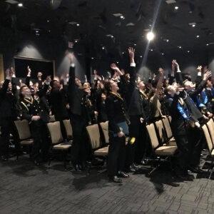 dma graduates throw their caps in the air